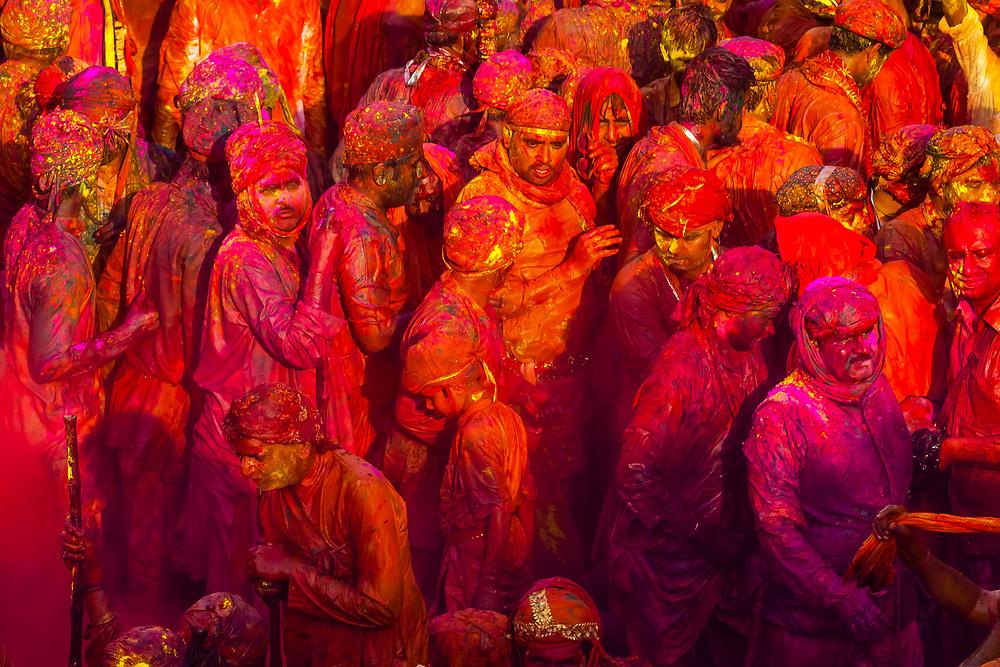 Large crowds celebrating Lathmar Holi in the village of Nandgaon, near Mathura, during Holi (festival of colors), Uttar Pradesh, India.
