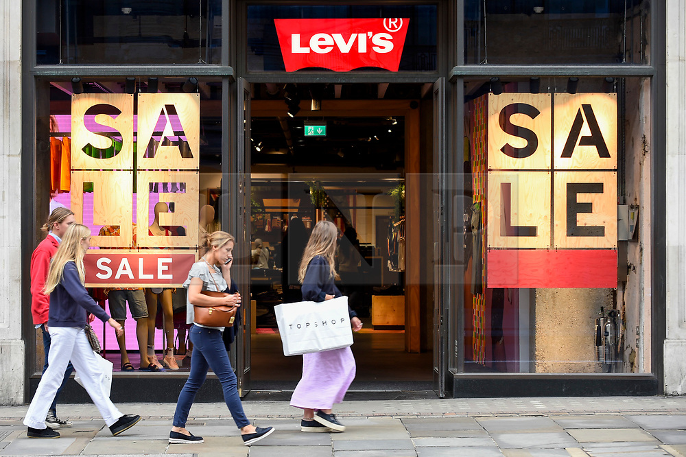 © Licensed to London News Pictures. 19/06/2019. LONDON, UK. Shoppers pass by a retail store on Regent Street as the Summer Sales season begins, with many stores offering large discounts to clear inventories.  As retailers continue to face the threat of online shopping, some well known high street store chains have proposed company voluntary arrangements (CVA) to try to reduce high fixed rental property costs.  Photo credit: Stephen Chung/LNP
