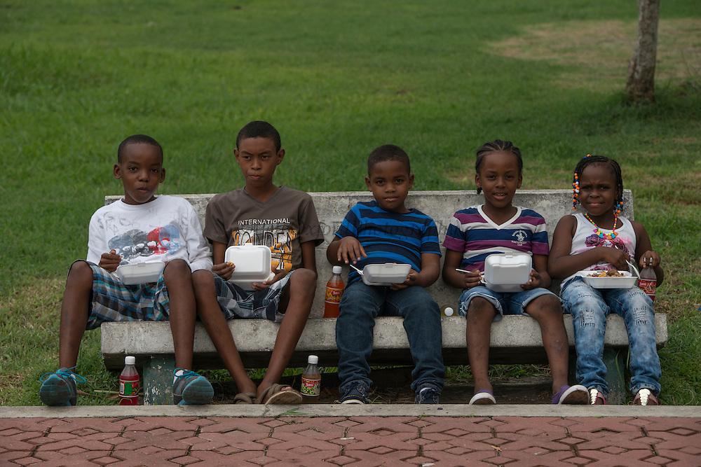 Kids having lunch<br /> Zoo<br /> Georgetown<br /> GUYANA<br /> South America