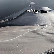 Skiing black snow on Mount Etna after a eruption.