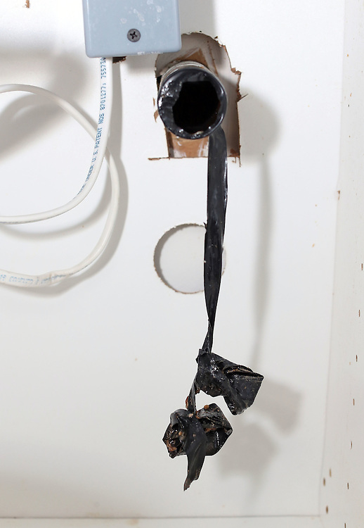 Appears to be homemade clog made out of electrical tape covering lower half of pipe after brand new pipes were installed under our sink by Jessreal Synder of Real's Clean & Neat Plumbing in Charlottesville, VA. Why would any plumber leave to pieces of balled up tape attached to each other then cover the lower half of your drain pipe with tape? Bad experience with this plumber. Would never recommend him to anyone.