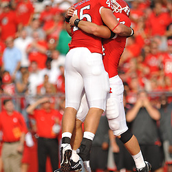 Sep 7, 2009; Piscataway, NJ, USA; Rutgers defensive end Alex Silvestro (45) celebrates with linebacker Ryan D'Imperio (44) after Silvestro intercepted a pass during the first half of Rutgers 47-15 loss to Cincinnati in NCAA college football at Rutgers Stadium.