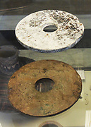 Chinese Neolithic Jade Bi Discs, Xia Dynasty (2100-1600BC) Stone rings were being made by the peoples of eastern China as early as the fifth millennium BC. Jade discs have been found carefully laid on the bodies of the dead in tombs of the Hongshan culture (about 3800-2700 BC), a practice which was continued by later Neolithic cultures.