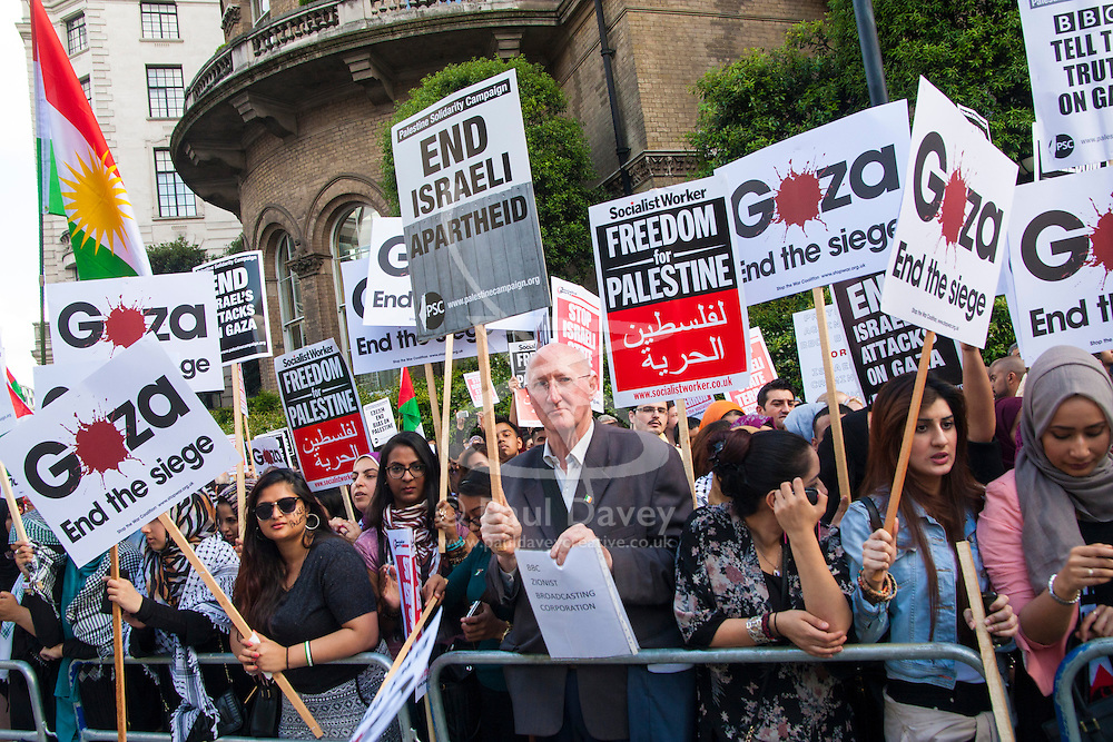 London, July 15th 2014. Palestinians and their supporters demonstrate outside the BBC's headquarters against an alleged pro-Israeli bias in their coverage of Palestinian affairs.