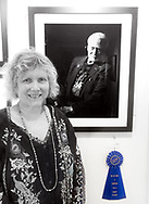 """Manhasset, New York, U.S., September 8, 2019. Ann Parry is honored her photo """"Buzz Aldrin"""" won 1st Place in The Art Guild's """"About Face: The Portrait"""" juried competition, at Elderfields, Manhasset, on Sept. 2019."""