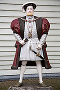 A statue of King Henry VIII of England outside the Mary Rose Museum in the Historic Naval Dockyard Portsmouth, Hampshire, UK.  King Henry VIII is know as the father of the Royal Navy.