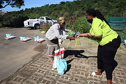 "SOUTH AFRICA - Durban - 30 April 2020 - Umgibe Stop Hidden Hunger project is about empowering communities in the townships of KwaZulu Natal, South Africa towards sustainable food pacels that they harvest in their site to the poorest communities. In the pic is the founder Nonhlanhla Joye ""Ma Joy"" preparing the food parcels for distribution to the recipents.<br /> Picture: Motshwari Mofokeng/African News Agency (ANA)"