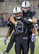 Nicholas Morello rides on the back of Ron Dogan after winning Cedar Ridge's first playoff game Friday, November 15, 2013 at Kelly Reeves Athletic Complex.  (LOURDES M SHOAF for Round Rock Leader)