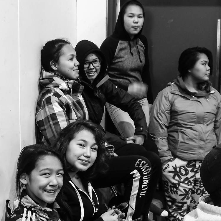 Bunch of inuit girls watching the dance competition.