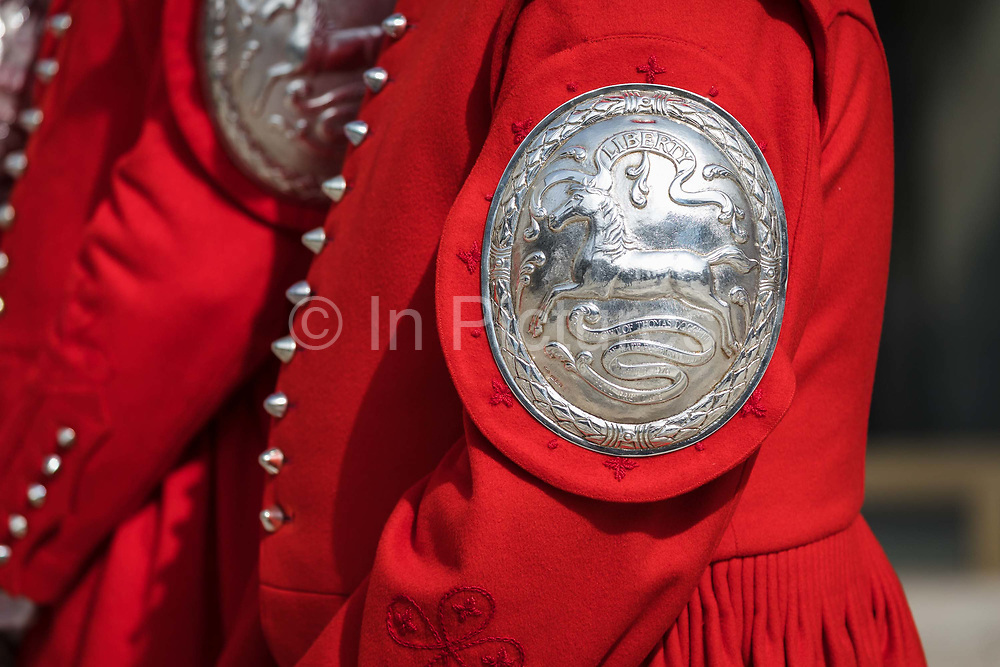 Badge detail of a Doggett's man in traditional dress at the launch of the Doggett's Coat And Badge Race Exhibition, with archives that reveal the previously secretive, traditional world of the Thames watermen, held in the Guildhall Yard in the City of London, England on September 10, 2018. The boat race for Doggett's Coat and Badge is the world's oldest continually completed sporting event dating back to 1715.