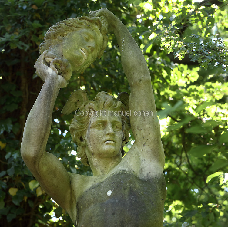 Statue of Perseus holding the head of Medusa, detail, in the Jardin d'Agronomie Tropicale, or Garden of Tropical Agronomy, in the Bois de Vincennes in the 12th arrondissement of Paris, France. The garden was first established in 1899 to conduct agronomical experiments on plants of French colonies. In 1907 it was the site of the Colonial Exhibition and many pavilions were built or relocated here. The garden has since become neglected and many structures overgrown, damaged or destroyed, with most of the tropical vegetation disappeared. The site is listed as a historic monument. Picture by Manuel Cohen