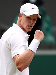 Kyle Edmund reacts during his match on day one of the Wimbledon Championships at the All England Lawn Tennis and Croquet Club, Wimbledon.