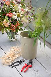 Flower arranging kit. Bucket, raffia, scissors and secateurs.