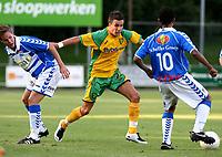 Photo: Maarten Straetemans.<br /> FC Zwolle v Norwich City. Pre Season Friendly. 25/07/2007.<br /> Jimmy Smith of Norwich City between two Dutch players