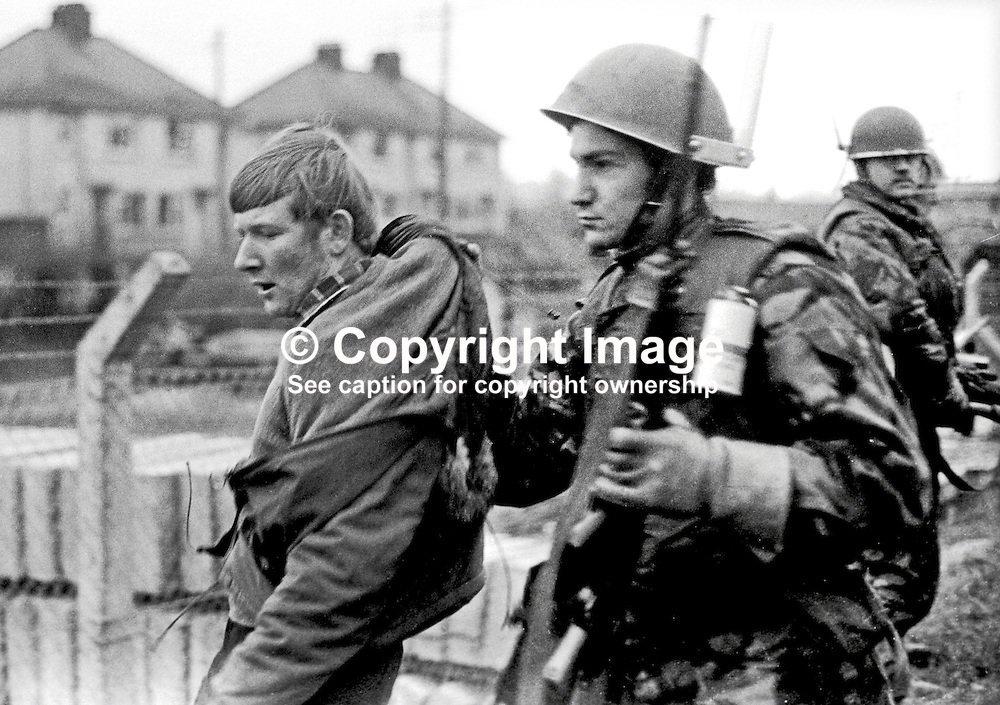 """A participant in the the Dungannon Civil Resistance Committee march to Coalisland on 23rd January 1972 is """"collared"""" by a British soldier attempting to  inforce the ban on marches imposed by Ulster Unionist Prime Minister Brian Faulkner on 18 January 1972. 197201230027c<br /> <br /> Copyright Image from Victor Patterson, Belfast, UK<br /> <br /> t: +44 28 9066 1296 (from Rep of Ireland 048 9066 1296)<br /> m: +44 7802 353836<br /> e: victorpattersonbelfast@gmail.com<br /> <br /> www.images4media.com<br /> <br /> Please see my full Terms and Conditions of Use at https://www.images4media.com/p/terms-conditions - it is IMPORTANT that you familiarise yourself with them.<br /> <br /> Images used online incur an additional cost. This cost should be agreed in writing in advance. Online images must be visibly watermarked i.e. © Victor Patterson or that of the named photographer within the body of the image. The original metadata must not be deleted from images used online.<br /> <br /> This image is only available for the use of the download recipient i.e. television station, newspaper, magazine, book publisher, etc, and must not be passed on to a third party. It is also downloaded on condition that each and every usage is notified within 7 days to victorpattersonbelfast@gmail.com.<br /> <br /> The right of Victor Patterson (or the named photographer) to be identified as the author is asserted in accordance with The Copyright Designs And Patents Act (1988). All moral rights are asserted."""