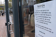 Signs in a closed shop window on the day that the second national lockdown came into effect, some people, many of whom are wearing face masks, come to the city centre as all non-essential shops are closed while others remain trading on 5th November 2020 in Birmingham, United Kingdom. The new national lockdown is a huge blow to the economy and for individual businesses who were already struggling with only offering limited services.