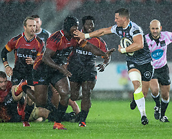 Shaun Venter of Ospreys under pressure from Thembelani Bholi of Southern Kings<br /> <br /> Photographer Simon King/Replay Images<br /> <br /> Guinness PRO14 Round 6 - Ospreys v Southern Kings - Saturday 9th November 2019 - Liberty Stadium - Swansea<br /> <br /> World Copyright © Replay Images . All rights reserved. info@replayimages.co.uk - http://replayimages.co.uk