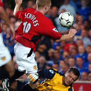 Chelsea goalkeeper Carlo Cudicini brings down Manchester United's Paul Scholes but Referee Graham Poll says no penalty