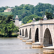 A view out over the Potomac River across Arlington Memorial Bridge, looking from the Washington DC side towards Lee House (Arlington House) on the opposite bank in Arlington National Cemetery.