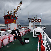 Argyll and Bute Counting Officer Charles Reppke takes the EU Referendum ballot box for the Isle of Gigha over on the Loch Ranza ferry from Tayinloan.<br /> <br /> There are 122 votes on Gigha and voting takes place in the local primary school, Gigha Primary. <br /> <br /> Picture Robert Perry  21st June 2016