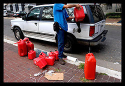 10th Sept, 2005. Hurricane Katrina, New Orleans, Louisiana. Bloomberg News journalist Oscar Sousa fills his car for another days reporting on the catastrophic events following the storm.