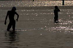 Athletes acclimate to the water early in the morning, prior to the competition's start