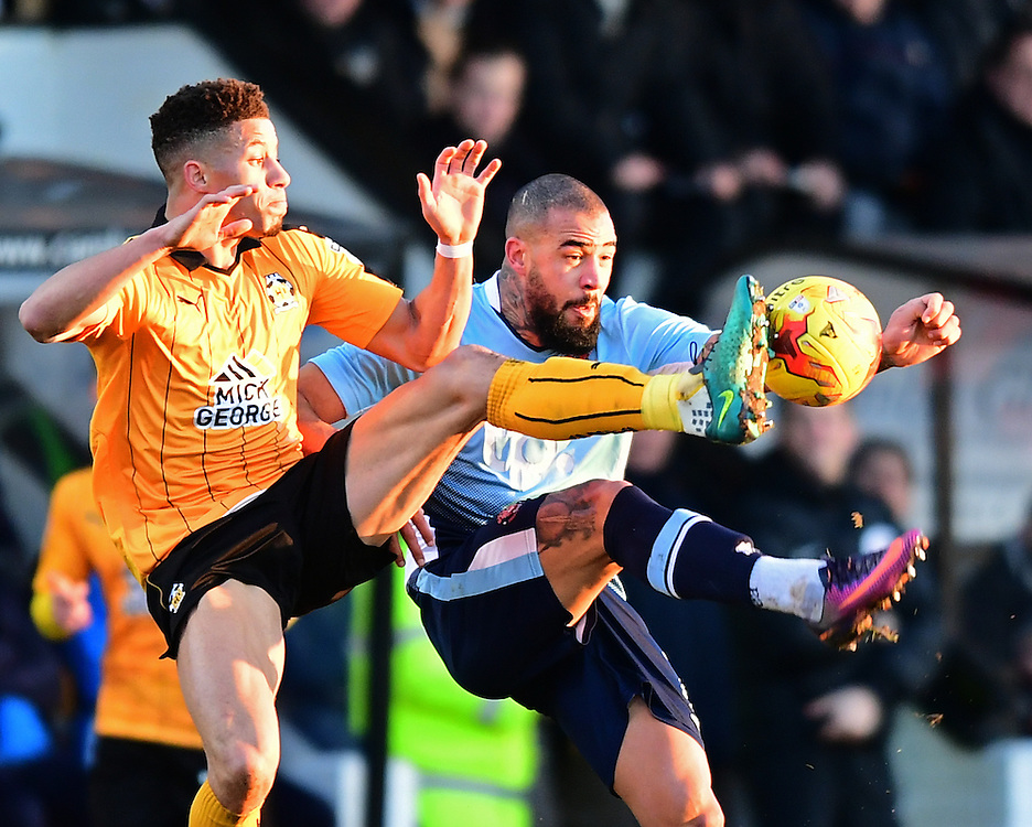 Blackpool's Kyle Vassell is tackled by Cambridge United's Jake Carroll<br /> <br /> Photographer Chris Vaughan/CameraSport<br /> <br /> The EFL Sky Bet League Two - Cambridge United v Blackpool - Saturday 14th January 2017 - The Cambs Glass Stadium - Cambridge<br /> <br /> World Copyright © 2017 CameraSport. All rights reserved. 43 Linden Ave. Countesthorpe. Leicester. England. LE8 5PG - Tel: +44 (0) 116 277 4147 - admin@camerasport.com - www.camerasport.com