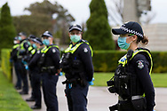 MELBOURNE, VIC - SEPTEMBER 12: A huge police presence is seen at the Shrine during the Melbourne Freedom Walk Rally on September 12, 2020 in Melbourne, Australia. Stage 4 restrictions are in place from 6pm on Sunday 2 August for metropolitan Melbourne. This includes a curfew from 8pm to 5am every evening. During this time people are only allowed to leave their house for work, and essential health, care or safety reasons. Despite this, multiple protests are being arranged to push back against the draconian restrictions in place within metropolitan Melbourne. A Freedom Walk was arranged to take place in the Tan but with hundreds of police and wet weather forecast, only a small number of protesters tried to attend before being ordered to move on. (Photo by Dave Hewison/Speed Media)