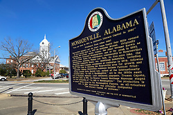 06 February 2015. Monroeville, Alabama.<br /> On the trail of Harper Lee's 'To Kill a Mocking Bird.'<br /> Signage for Monroeville with the old courthouse in the background. The courtroom was used as the model for the Hollywood movie. The building is now the Monroe County Museum at the center of the old town. <br /> Photo; Charlie Varley/varleypix.com