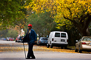 Will Mitchell walks along 16th Street in Galveston, Texas as fall color fills trees in the East End Historic District.
