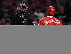 May 16, 2018 - Anaheim, CA, U.S. - ANAHEIM, CA - MAY 16: Los Angeles Angels of Anaheim pinch hitter Luis Valbuena (18) talks with plate umpire Chris Conroy (98) after Valbuena was called out on strikes in the ninth inning of a game against the Houston Astros played on May 16, 2018 at Angel Stadium of Anaheim in Anaheim, CA.(Photo by John Cordes/Icon Sportswire) (Credit Image: © John Cordes/Icon SMI via ZUMA Press)