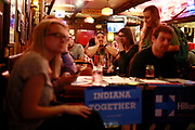 04202015 - Bloomington, Indiana, USA:  Viewers react at Nick's English Hut, as Hillary Clinton admits her e-mail mistake, while watching Donald Trump and Clinton on television during their first 2016 presidential election debate. (Jeremy Hogan/Polaris)