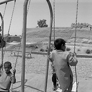 Afghan boys play on swings in Dand District South of Kandahar City, Afghanistan. In 2009 this district teetered on the verge of collapse as insurgents operated freely intimidating and terrorizing the local population and government officials. Although it is not completely secure, a long term counterinsurgency (COIN) operation implemented by Canadians turned the area around. (Credit Image: © Louie Palu/ZUMA Press/The Alexia Foundation).....