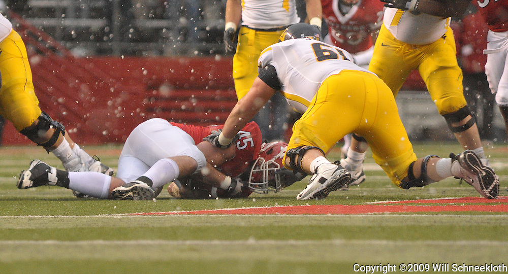 Dec 5, 2009; Piscataway, NJ, USA; Rutgers defensive end Alex Silvestro (45) recovers a fumble during second half NCAA Big East college football action in West Virginia's 24-21 victory over Rutgers at Rutgers Stadium.