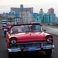 Central America, Cuba, Havana. Classic convertible on the Malecon.