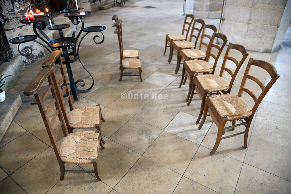 group of old style wooden chairs in church St. Eustache France Paris
