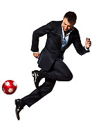 one caucasian business man playing juggling soccer ball in studio isolated on white background