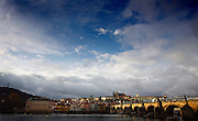 """SHOT 11/21/08 7:41:38 AM -  The Prague Castle and Charles Bridge in Prague, Czech Republic. Prague Castle (Czech: Pra?ský hrad) is a castle in Prague where the Czech kings, Holy Roman Emperors and presidents of Czechoslovakia and the Czech Republic have had their offices. The Czech Crown Jewels are kept here. Prague Castle is one of the biggest castles in the world (according to Guinness Book of Records the biggest ancient castle) at about 570 meters in length and an average of about 130 meters wide. Charles Bridge is a famous historical bridge that crosses the Vltava river in Prague, Czech Republic. The bridge is 516 meters long and nearly 10 meters wide, resting on 16 arches shielded by ice guards. It is protected by three bridge towers, two of them on the Lesser Quarter side and the third one on the Old Town side. The Old Town bridge tower is often considered to be one of the most astonishing civil gothic-style buildings in the world. The bridge is decorated by a continuous alley of 30 statues and statuaries, most of them baroque-style, erected around 1700. Prague is the capital and largest city of the Czech Republic. Its official name is Hlavní m?sto Praha, meaning Prague, the Capital City. Situated on the River Vltava in central Bohemia, Prague has been the political, cultural, and economic centre of the Czech state for over 1100 years. The city proper is home to more than 1.2 million people, while its metropolitan area is estimated to have a population of over 1.9 million. Since 1992, the extensive historic centre of Prague has been included in the UNESCO list of World Heritage Sites. According to Guinness World Records, Prague Castle is the largest ancient castle in the world. Nicknames for Prague have included """"the mother of cities"""", """"city of a hundred spires"""" and """"the golden city"""". Since the fall of the Iron Curtain, Prague has become one of Europe's (and the world's) most popular tourist destinations. It is the sixth most-visited European city after London"""
