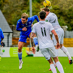 Conor McDonagh goes up for the challenge with Ed Palmer Truro City 24/10/2020