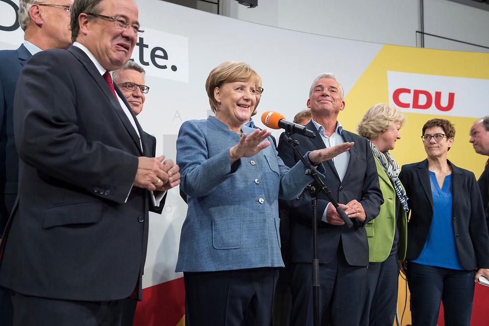 24 SEP 2017, BERLIN/GERMANY:<br /> Angela Merkel (M), CDU, Bundeskanzlerin, eingerahmt von Joachim Herrmann, Armin Laschet, Thomas de Maiziere, Thomas Strobl, Monika Gruetters, Annegret Kramp-Karrenbauer, Philipp Murmann, (v.L.n.R.), Wahlparty in der Wahlnacht, Bundestagswahl 2017, Konrad-Adenauer-Haus, CDU Bundesgeschaeftsstelle<br /> IMAGE: 20170924-01-060<br /> KEYWORDS: Election Party, Election Night