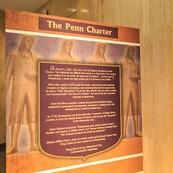 Information about the Penn Charter granting Pennsylvania by King Charles II on display inside the state museum in Harrisburg, PA.