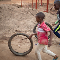 Children play in a neighbourhood of Butembo where the community built a well with support from IMA and Tearfund. Clean drinking water underpins many initiatives for healthcare in  the region.