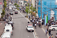 May 28, 2019, Kawasaki, Japan: A man wielding knives went on a morning rampage attacking people at a bus stop close to Noborito Station in a sleepy suburb outside Tokyo. This view shows the bus stop (center) and area where stabbed victims lay bleeding (blue draped building corner). Three died and sixteen were injured with three still in critical condition. Many of the victims were children waiting for their school bus to take them to Caritas Gakuen, a Catholic elementary school located about one kilometer from the scene. Caritas was founded by Soeurs de la Charite de Quebec, a Catholic nun organization from Quebec, Canada. Among the dead were 11 year old Hanako Kuribayashi, a female sixth grader from Tokyo, and 39 year old Satoshi Oyama from Tokyo, an employee of Japan's Foreign Ministry. Oyama is the father of a student at the school who was not injured in the attack. The third death was the attacker, a 51 year old resident of Kawasaki who died from a self inflicted neck wound. His motive for the attack which began shortly after 7:30 am is unknown. Japan is one of the safest nations in the world which tightly controls weapon ownership, both guns and swords. Even so, knife rampages continue with the last one occurring in 2016 when a man attacked a mental care facility in Tsukui City killing 19 patients. Photo by Torin Boyd.