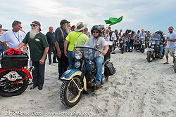Matt McManus riding his 1936 Harley-Davidson Knucklehead passes through the start on the sands of Daytona Beach at the beginning of stage 1 of the Motorcycle Cannonball Cross-Country Endurance Run, which on this day ran from Daytona Beach to Lake City, FL., USA. Friday, September 5, 2014.  Photography ©2014 Michael Lichter.
