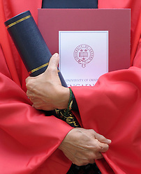 © Licensed to London News Pictures. 20/06/2012. Oxford, UK Aung San Suu Kyi hold her degree as she leaves Oxford University today 20 June 2012 after receiving an Honary Degree at the Encaenia Ceremony.  The Burmese democracy leader is to receive an honorary doctorate in civil law at annual ceremony honouring the brightest and best. Other honorees include: former MI5 Director General Baroness Manningham-Buller; author David John Moore Cornwell (aka John le Carre); Harvard University president Professor Drew Gilpin Faust; and Sony chief executive Sir Howard Stringer. Photo credit : Stephen Simpson/LNP