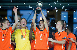 Pascal Huser of Netherlands, Mike Havekotte of Netherlands, Rai Vloet of Netherlands and Jorrit Hendrix of Netherlands celebrate with a trophy after winning the UEFA European Under-17 Championship Final match between Germany and Netherlands on May 16, 2012 in SRC Stozice, Ljubljana, Slovenia. Netherlands defeated Germany after penalty shots and became European Under-17 Champion 2012. (Photo by Vid Ponikvar / Sportida.com)