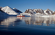 """Magdalenefjord at 79 degrees N in north-western Spitsbergen, Svalbard.  the expedition vessle """"Polar Star"""" is anchored here this early morning in June."""