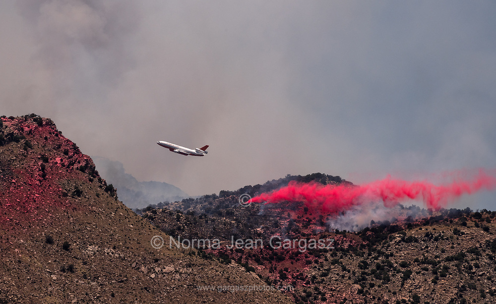 A tanker drops slurry on the Bighorn Fire in the Santa Catalina Mountains, Sonoran Desert, Coronado National Forest, Tucson, Arizona, USA.  The lightning-caused fire started on June 5, 2020.
