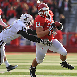 Oct 10, 2009; Piscataway, NJ, USA; Rutgers FB Jack Corcoran (19) runs through the tackle of Texas Southern defensive back Kydarian Wilkins during first half NCAA college football action between Rutgers and Texas Southern at Rutgers Stadium.
