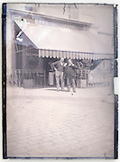 buddies in front of cafe Paris 1900s